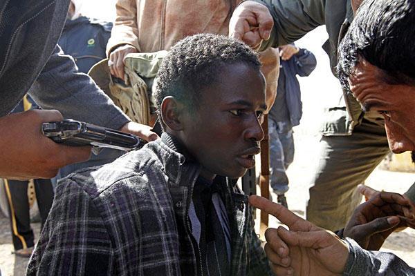 Αποτέλεσμα εικόνας για libya slaves upside down