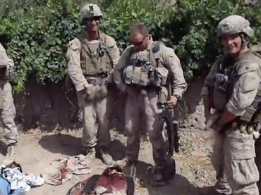 A still image taken January 11, 2012 from an undated YouTube video shows what is believed to be U.S. Marines urinating on the bodies of dead Taliban soldiers in Afghanistan. (Reuters/YouTube)