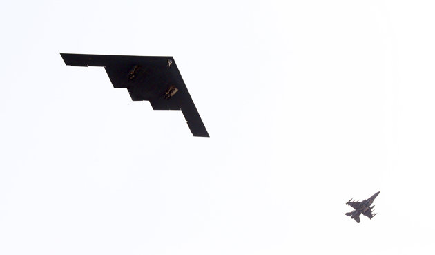 Associated Press/Lee Jung-hun, Yonhap - U.S. Air Force B-2 stealth bomber, left, flies over near Osan U.S. Air Base in Pyeongtaek, south of Seoul, South Korea, Thursday, March 28, 2013. A day after shutting down a key military hotline, Pyongyang instead used indirect communications with Seoul to allow South Koreans to cross the heavily armed border and work at a factory complex that is the last major symbol of inter-Korean cooperation. (AP Photo/Lee Jung-hun, Yonhap) KOREA OUT