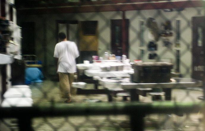 "This image reviewed by the US military shot through a one way mirror shows a detainee in Cell Block B of the ""Camp Six"" detention facility of the Joint Detention Group at the US Naval Station in Guantanamo Bay, Cuba, January 19, 2012. (AFP Photo/Jim Watson)"