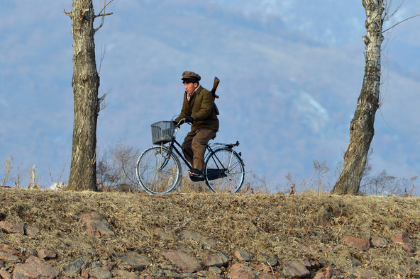 A North Korean soldier rides a bicycle beside a river crossing on the Yalu River near the North Korean town of Sinuiju. Mark Ralston/Agence France-Presse — Getty Images