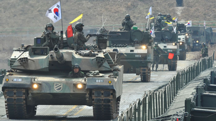 South Korean K-1 tanks move over a temporary bridge during a river-crossing military drill in Hwacheon near the border with North Korea on April 1, 2013.(AFP Photo / Kim Jae-Hwan)