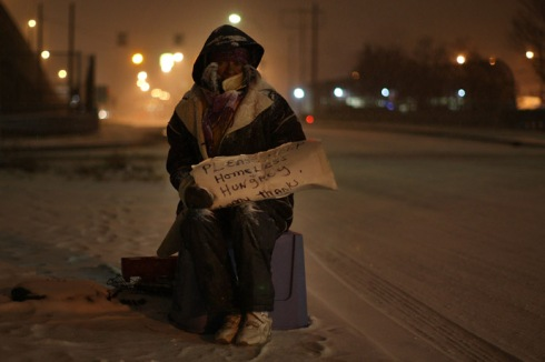 A homeless woman begs for money at an intersection in Detroit, Michigan. (Spencer Platt/Getty Images/AFP)