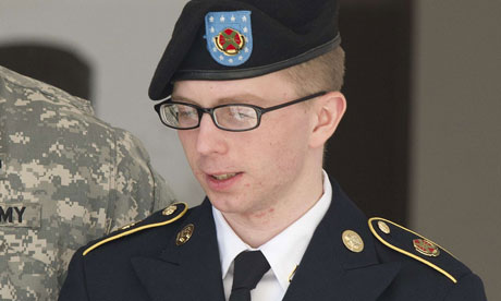 (FILES)PFC Bradley Manning is escorted by military police as he departs the courtroom at Fort Meade, Maryland in this April 25, 2012 file photo. Photograph: Jim Watson/AFP/Getty Images