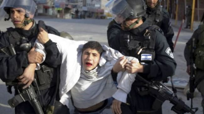 Israeli troops arrest a Palestinian youth at the Shuafat refugee camp in al-Quds in February 2010.