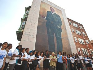 (Students from Paul Robeson High School help to rededicate the Paul Robeson mural. Photo by Steve Weinik, provided.)