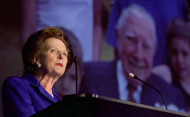 Margaret Thatcher stands in front of an image of Augusto Pinochet at a Conservative Party conference. (Reuters Photo)