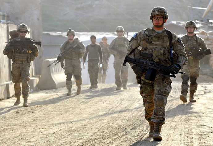 US army soldiers march from the Forward Base Honaker Miracle at Watahpur District in Kunar province. (AFP Photo / Manjunath Kiran)