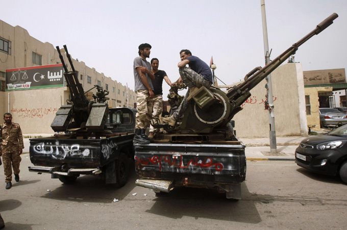 Gunmen controlled a number of ministry buildings in Tripoli after occupying them earlier this week [Reuters]