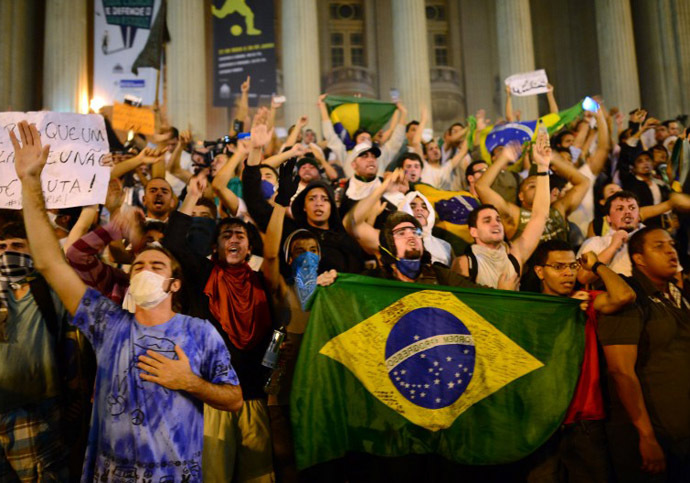 Demonstrators shout slogans outside the Municipal theatre in downtown Rio de Janeiro on June 17, 2013. (AFP Photo / Christophe Simon)