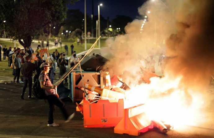 Demonstrators set fire to traffic signs during a protest at the Antonio Carlos Avenue, next to Mineirao stadium which hosts the Confederations Cup, on June 17, 2013. (AFP Photo / Bernardo Salce)