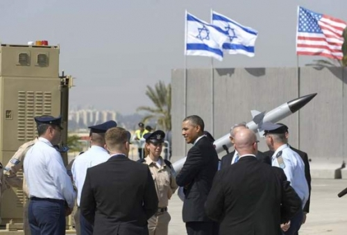 U.S. President Barack Obama chats with military personnel while viewing an Iron Dome missile battery on March 20 at Israel's Ben Gurion International Airport.
