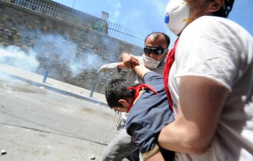 A bleeding protester is assisted after being attacked by riot police on 1 June 2013, during an anti-government protest in Taksim Square in Istanbul. (Photo: AFP - Bulent Kilic)