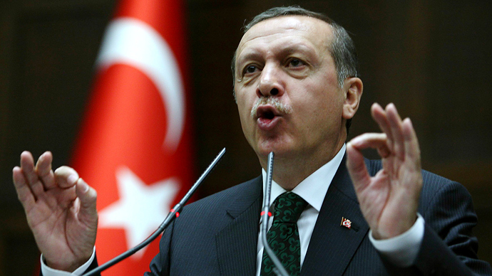 Turkey's Prime Minister Recep Tayyip Erdogan addresses members of parliament from his ruling AK Party (AKP) during a meeting at the Turkish parliament in Ankara on June 11, 2013 (AFP Photo / Adem Altan)