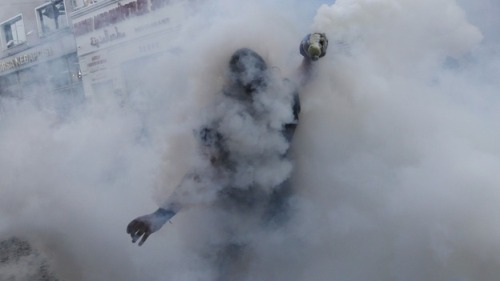 REUTERS/Murad Sezer A protester in Turkey braves tear gas.