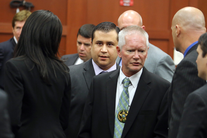 George Zimmerman leaves the courtroom a free man after being found not guilty, on the 25th day of his trial at the Seminole County Criminal Justice Center July 13, 2013 in Sanford, Florida (AFP Photo / Joe Burbank)