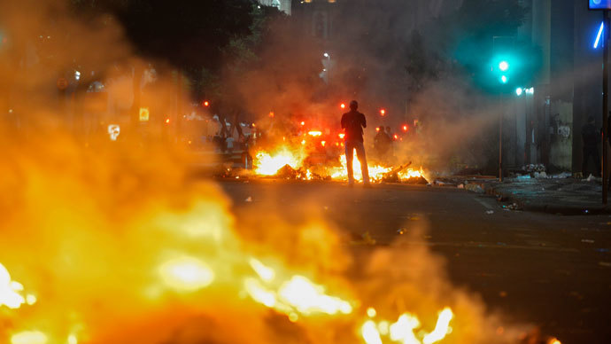 A man stands between bonfires lit by demonstrators as they clashed with police during an anti-government protest in Rio de Janeiro June 20, 2013.(Reuters / Luciana Whitaker)
