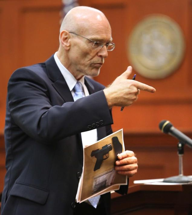 Don West, a defense attorney for George Zimmerman makes a gun gesture, describing the shooting of 17-year-old Trayvon Martin to the jury.