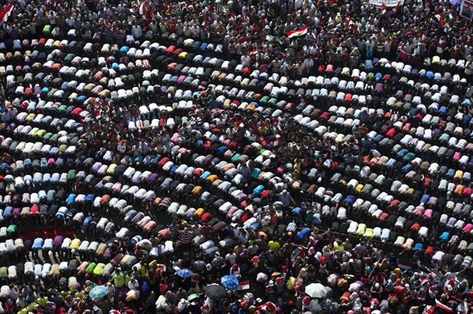 Thousands of opponents of Egyptian President Mohamed Morsi pray during a protest calling for his ouster at Cairo's landmark Tahrir Square on June 30, 2013 (AFP Photo / Khaled Desouki)