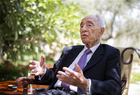 Israel's President Shimon Peres speaks during an interview with Reuters at his residence in Jerusalem …