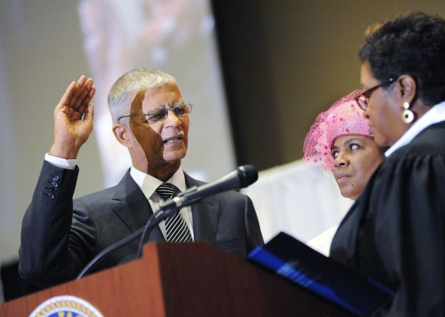 Jackson (Miss.) Mayor Chokwe Lumumba recites the oath of office as friend Gloria Elmore, center, and Hinds County Chancery Judge Patricia Wise look on during an inauguration ceremony on Monday, July 1, 2013 at the Jackson Convention Complex. Photo: The Clarion-Ledger, Joe Ellis
