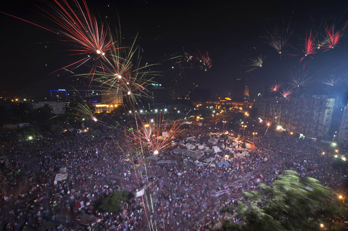 Fireworks light up the sky as Hundreds of thousands of Egyptians celebrate after Egytptian Defense Minister Abdel Fattah al-Sisi's speech announcing The Egyptian army toppling Islamist President Mohamed Morsi in Egypt's landmark Tahrir square on July 3, 2013 in Cairo, Egypt AFP Photo / Khaled Desouki)