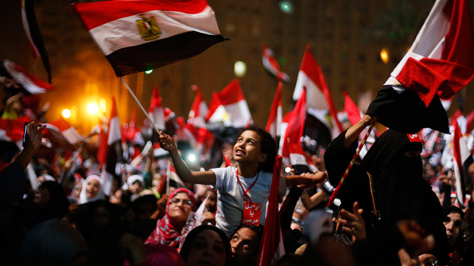 Protesters, who are against Egyptian President Mohamed Mursi, react in Tahrir Square in Cairo July 3, 2013 (Reuters / Suhaib Salem)