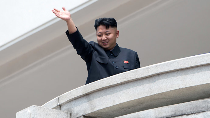 North Korean leader Kim Jong-Un waves to the crowd during a military parade at Kim Il-Sung square marking the 60th anniversary of the Korean war armistice in Pyongyang on July 27, 2013. (AFP Photo/Ed Jones)