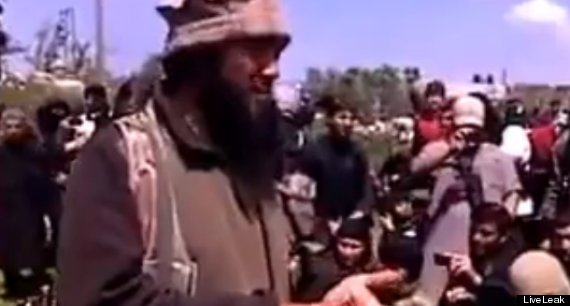 A still from unconfirmed footage which purports to show Father Murad's death by beheading