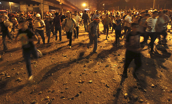 Anti-Mursi protesters run during clashes with members of the Muslim Brotherhood and supporters of ousted Egyptian President Mohamed Morsi near Maspero, Egypt's state TV and radio station, near Tahrir square in Cairo July 5, 2013. (Reuters / Amr Dalsh)