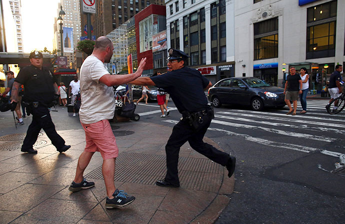 A police officer prevents a man from marching to Times Square during a rally in reaction to the acquittal of George Zimmerman in New York July 14, 2013. (Reuters / Eric Thayer)