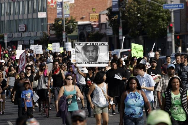 Demonstrators in Los Angeles protest the acquittal of George Zimmerman in the Trayvon Martin trial on Sunday.