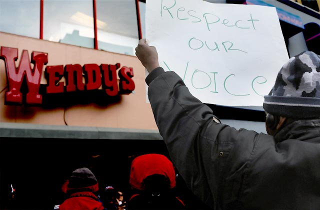 Fast food workers and their supporters demonstrate outside of a Wendy's restaurant in New York City during a Nov. 29, 2012, walk-out. Labor organizers have staged similar walkouts in six cities thus far. Spencer Platt/Getty Images