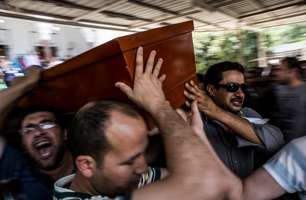 Bryan Denton for The New York Times Men carried the body of a relative out of a mosque in Cairo, where the dead from Wednesday were taken for identification.