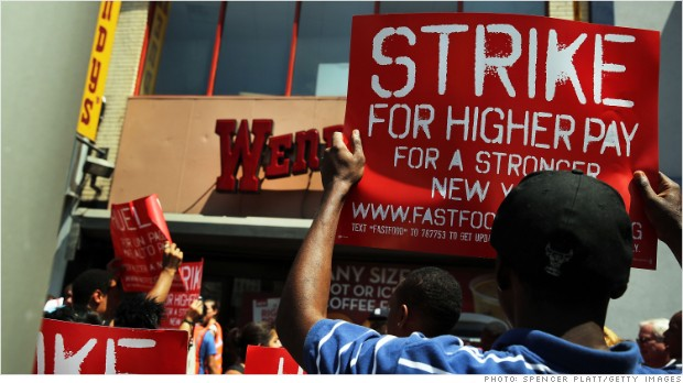Workers are protesting about pay and want their hourly rate to rise to $15 from around $9.