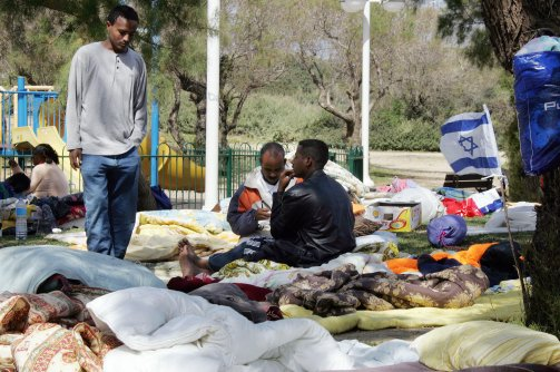 African asylum seekers from Ivory Coast and Eritrea gather at a public park in Tel Aviv on March 13, 2008. (Jack Guez /AFP / Getty Images)
