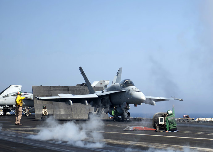 US Navy shows an F/A-18C Hornet assigned to the Rampagers of Strike Fighter Squadron (VFA) 83 preparing to launch from the flight deck of the aircraft carrier USS Dwight D. Eisenhower (CVN 69) on June 17, 2013 in the Mediterranean Sea. (AFP Photo)