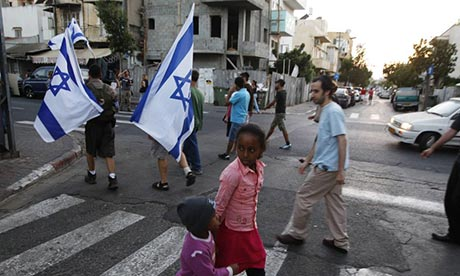 Tel Aviv residents protest against African migrants in their neighbourhood in 2012. Photograph: Baz Ratner/Reuters