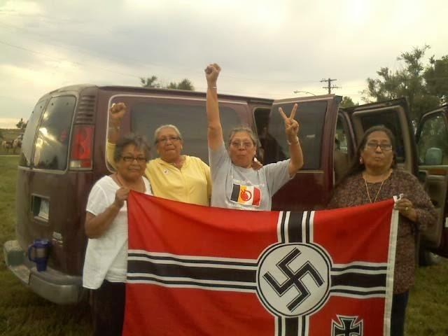 Lakota Grandmothers Caputre Fascist Flag in Leith!