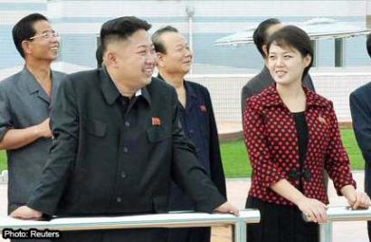 North Korean leader Kim Jong-Un and his wife, named as Ri Sol-ju, visit the Rungna People's Pleasure Ground in Pyongyang in these undated pictures.