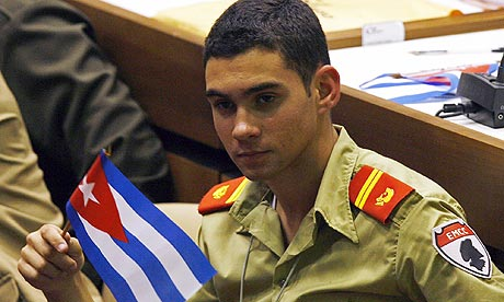 Elian Gonzalez holds a Cuban flag during the Union of Young Communists congress in Havana. Photograph: Ismael Francisco/AP