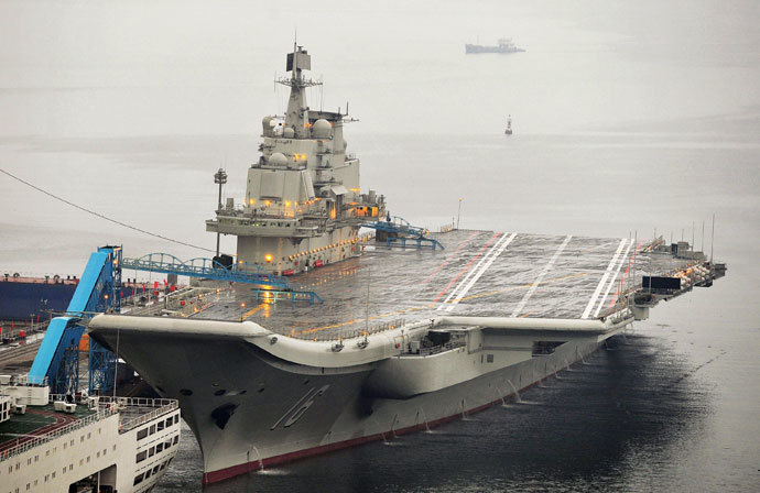 China's first aircraft carrier, which was renovated from an old aircraft carrier that China bought from Ukraine in 1998, is seen docked at Dalian Port, in Dalian, Liaoning province.(Reuters / Stringer)