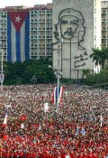 Hundreds of thousands of Cubans participate in the May Day celebration, May 1, 2003 2003 in Havana's Revolution Square, Havana, Cuba At back is a Cuban flag and a sculpture of Che Guevara.  (AP Photo/Jose Goitia)